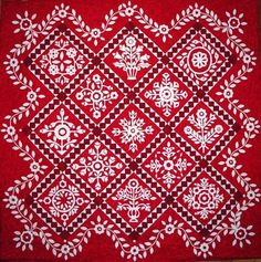 This quilt pattern is called: Whitework Sampler by The Rabbit Factory.  Red with white is lovely.  I have the pattern and the creme applique work is on a lighter brown with darker brown borders.  See it here:  http://pinterest.com/pin/80150068341174869/