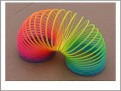 Slinky - metal ones were the best...mom always had to untangle them for me