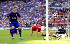 Ibrahimovic watches on as his header squirms past Schmeichel, going in off the Leicester p...
