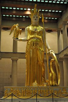 A larger than life statue of the Goddess Athena at a Replicated Parthenon in Nashville, Tennessee. This statue is a reproduction of the Athena Parthenos. She's depicted with an owl, her helm, a spear/staff, and a large shield. Greek And Roman Mythology, Greek Gods, Medusa And Athena, Machu Picchu, Parthenon Nashville, Athena Goddess, Statues, Right Brain, Virtual Museum
