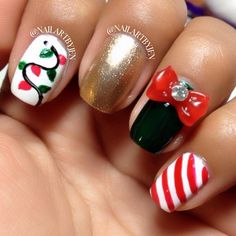 Image from http://fashion.entertainmentnewsexpress.com/uploads/201411/28/ca/candy%20cane%20nails%20with%20bowknot%20diamond%20and%20christmas%20lights%20for%202014%20christmas%20-%20golden%20nail%20polish%20d-f46265.jpg.