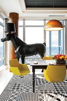 Moooi's horse lamp anchors the dining room.  mangodesignco.ca #mangodesignco