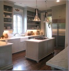 1. Shaw farm sink, Polished nickel bridge faucet.     2.  Benjamin Moore Fieldstone paint on the cabinets and trim, white on the walls, dark wood floors.  2.  Carrara marble countertops, subway tile backsplash.  3.  Remove cabinet doors, use 2 to 3� thick shelves, and attach brackets under cabinets.    4. Center island �