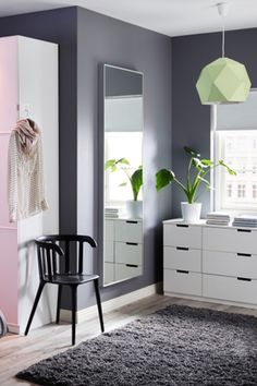 Open up a small bedroom space by adding a mirror - like the IKEA HOVET mirror - on a wall!