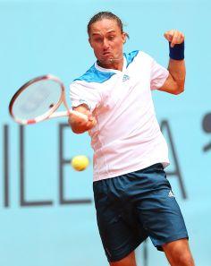 Alexandr Dolgopolov Photos - Mutua Madrid Open: Day 4 - Zimbio