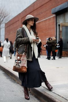 Love this look - the bag, the jacket, the long skirt... boots ... got it goin' on!