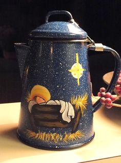 Nativity Painted Blue Speckled Metal Enamelware Coffee Pot is hand-painted with a nativity scene ... the speckles representing stars in the night sky ... the Christmas Star has also been painted on to reflect that first Christmas night. This will be a sign to you: You will find a baby wrapped in cloths and lying in a manger. Luke 2:12 Paint has been sealed with several coats of varnish. Would make a great addition to your Nativity collection! For decorative purposes only. Do not immerse in…