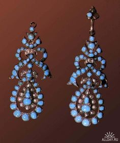 The silver and turquoise earrings from the 18th century. Russia. Museum of St. Petersburg
