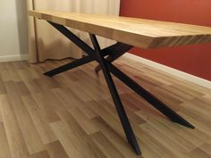 Table made from reclaimed parquet on steel base - legs