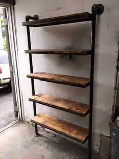 Industrial piping and distressed wood shelving unit