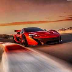 McLaren P1 racing at sunset