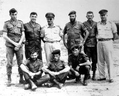 "Ariel ""Arik"" Sharon (2nd from left, standing) 11th PM of Israel and renowned battle commander, who died on Jan 11, 2014, stands next to another legendary Israeli general, Moshe Dayan (with eye patch) in this photo taken after Operation Egged in Nov 1955. Both men played critical roles in the Arab-Israeli wars of the 20th century."