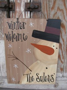 Primitive Hand Painted Personalized Snowman Sign Plaque. I have frosty the snowman hand painted on our signature personalized sign boards.