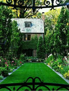 Idea for small yard / garden. Fake grass and flowers on one side, the other side could be your veggie garden and at the end place patio set. G;)