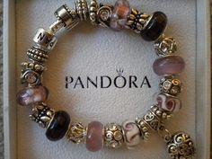 http://www.ebay.com/itm/Gorgeous-Pandora-Bracelet-Plum-Murano-Glass-Beads-Silver-Charms-/300700055857?pt=Designer_Jewelry=item46031eb931#ht_1054wt_1482