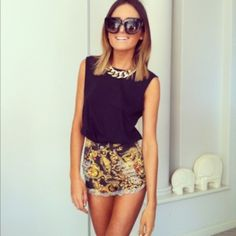 Shorts, black top, thick gold chain necklace