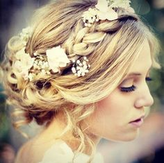 Get inspired: A beautiful braided updo that also functions as part of a #bridal flower crown.