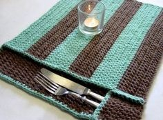 Crochet placemat with silverware pocket. No pattern.