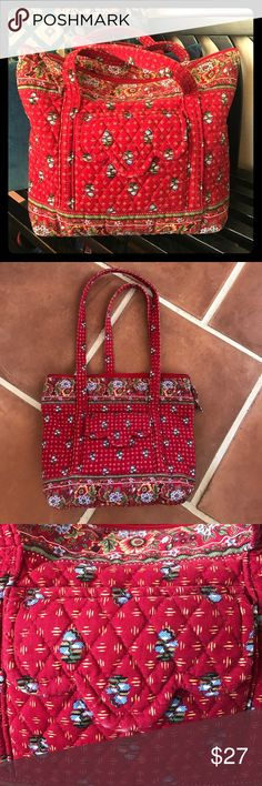 """Red Vera Bradley Fabric Bag This beautiful bag is in excellent shape. Red Floral pattern. Outer pocket has a little ware. Zipper inclosure. 6 interior pockets. 8 pockets total on bag. Bag measures- 14""""X11"""" Vera Bradley Bags"""