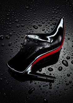 Louboutin , black patent shoe, water drops, still-life, still-life photographer, still-life photography, still-life photographer London, luxury fashion accessories, luxury fashion photography, luxury fashion product photography, David Parfitt.
