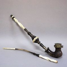http://www.ebay.com/itm/1800s-Interesting-GERMANIC-PIPE-STEM-SHAFT-CARVED-HORN-very-SPECIAL-INLAY-Dots-/231569563539?pt=LH_DefaultDomain_2