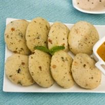 Oats Idli Recipe - Low on carbs and healthy idlis made with oats and grated carrots. Ideal for those who are calorie conscious.