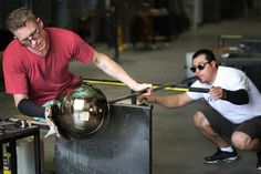 Part of the glass-blowing process for member Niche Modern's Terra lamp.