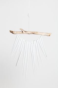 30 Apartment Buys To Spend That Bonus On #refinery29  http://www.refinery29.com/adult-apartment-decorations#slide-6  This wall hanging looks like you got it from some cool festival.