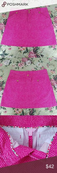 "Lilly Pulitzer Skirt Adorable Lilly Pulitzer Pink Chevron Print Skirt. Signature Logo Gold-Tone Buttons. 2 Slash Front Pockets and 2 Back Pockets. Zipper and Button Closure. 98% Cotton and 2% Spandex. 15"" in Length.  Has a Heavier Weight to it with a Brushed  Courderoy Feel. Great for Fall and Winter.  Beautiful Finished Detailed Hem.  Excellent Condition! Lilly Pulitzer Skirts Mini"