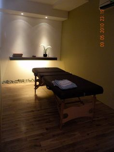 Massage room...lighting is nice and simplicity is often elegance at its best.... Think I'm finding my style