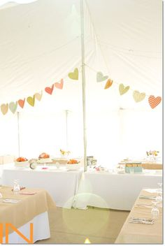 Wedding reception tent decorated with a pastel color palette, perfect for spring.