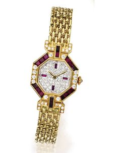 #chronowatchco Cartier watch in 18-carat yellow gold. Features an octagonal watch face set with 16 rubies and diamonds.at Sotheby's New York very nice http://www.shop.com/sophjazzmedia/~~cartier+watches-internalsearch+260.xhtml