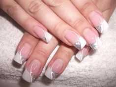 Wedding manicure with silver glittering nail polish .