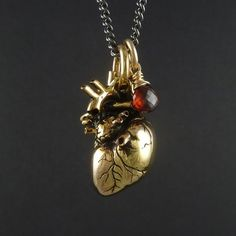 Anatomical Gold Plated Heart Pendant with Red Garnet by Lost Apostle