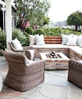 Cool idea for our patio area. Built in brick sectional with wood slat back.