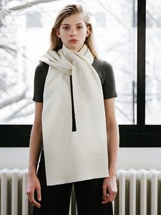 'Breaks in continuity' comments on the conventional ways of wearing a scarf…