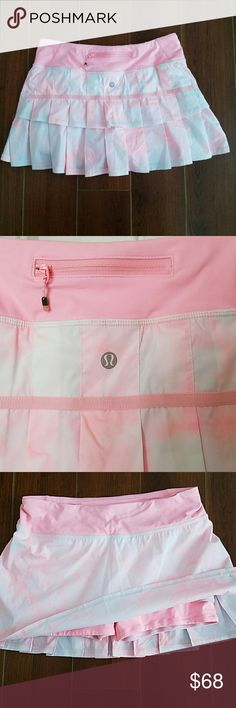 Lululemon Pace Setter Skirt Spray Dye Pink Coral NWOT. Never been worn Pace Setter tennis and running skirt. Size 4 reg. Color is spray dye pink coral and white. Inner shorts are Luxtreme and are coral colored.  Has back zip pocket, two front pockets and a side pocket on the shorts for a tennis ball. lululemon athletica Skirts