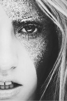 Glitter eye makeup.                                                                                                                                                     More