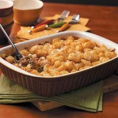 Pizza Tot Casserole -  You'll need just seven basic ingredients to make this effortless upside-down pizza casserole. Since I cook for two, I often divide it into two smaller casserole dishes - one for dinner and one to freeze. I take the frozen portion out of the freezer the night before to thaw in the fridge before baking as directed