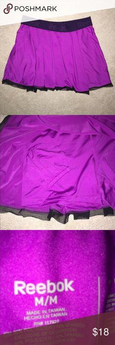 Reebok purple tennis skirt size M NWOT New without rage purple reebok tennis skirt with shorts built in with pocket for ball. NWOT size medium Reebok Skirts