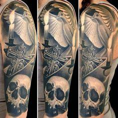 Men skull sleeve tattoo with cross