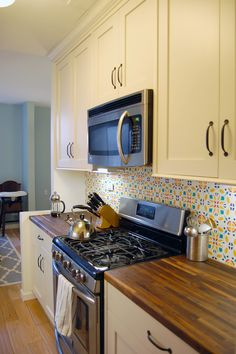 our final kitchen design, with my awesome temporary DIY backsplash.