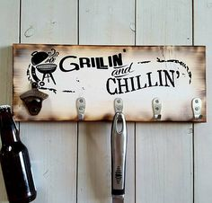 The Grillin & Chillin Wood Sign. All of you grill masters need one of these BBQ utensil holder signs for your deck, beach house or lake house then youll be able to do the perfect grilling while kicking back and drinking your favorite beverage on a hot summer day! These barbecue grill signs make the perfect Fathers Day gift for your dad or hubby or for any man in your life! This sign is made with solid pine wood that is then finished in a unique burned wood technique and distressed white p...