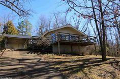 Private wooded retreat! Enjoy the peace and quiet of this 2 bedroom, 1 bath bungalow featuring an open layout with vaulted ceilings, central heat & air, and gas log fireplace. This charming home has a new roof in 2017, large front deck, and covered rear patio. This home is being sold furnished so all it needs is you! in Cherokee Village AR