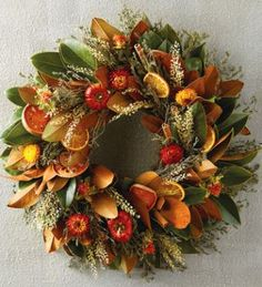 This magnolia leaf wreath is enlivened with slices of quince and orange, cinnamon sticks, and dried flowers, making it a perfect addition to your fall decorations. Wreaths And Garlands, Holiday Wreaths, Christmas Decorations, Floral Wreaths, Dried Orange Slices, Dried Oranges, Dried Fruit, Magnolia Wreath, Magnolia Leaves