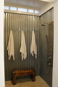 Corrugated metal shower.  Probably not a 10yr solution, but fun and  simple.  I wonder if you could do a sand floor.