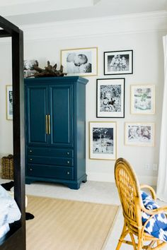 Home Tour: master bedroom (armoire makeover painted in @benjamin_moore Hale Navy with black and white gallery wall