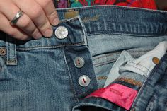 Fixing jeans with a broken zipper using buttons instead