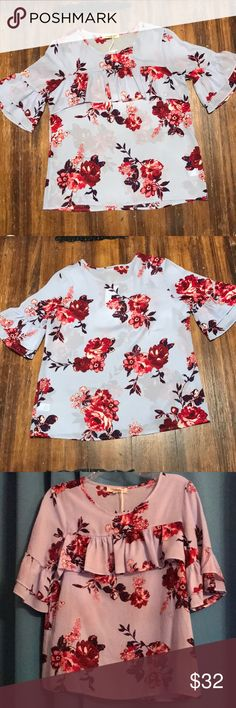 Living Doll floral print top NWT Living Doll Top.  Size Medium. (Junior fit). Ruffles across the front.  Ruffle sleeve.  Lilac purple with dark maroon (chambray red) flowers. living doll Tops