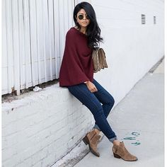 Chic and casual in a burgundy top and dark-washed jeans